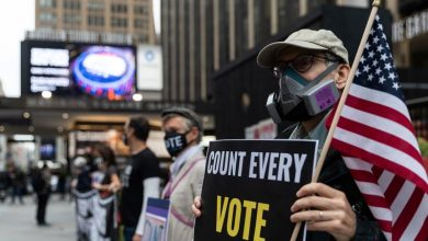 Photo of Fired-up New Yorkers stand in line for hours to cast early votes
