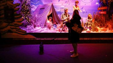 Photo of Unbowed by coronavirus, Paris department store lights up Christmas display